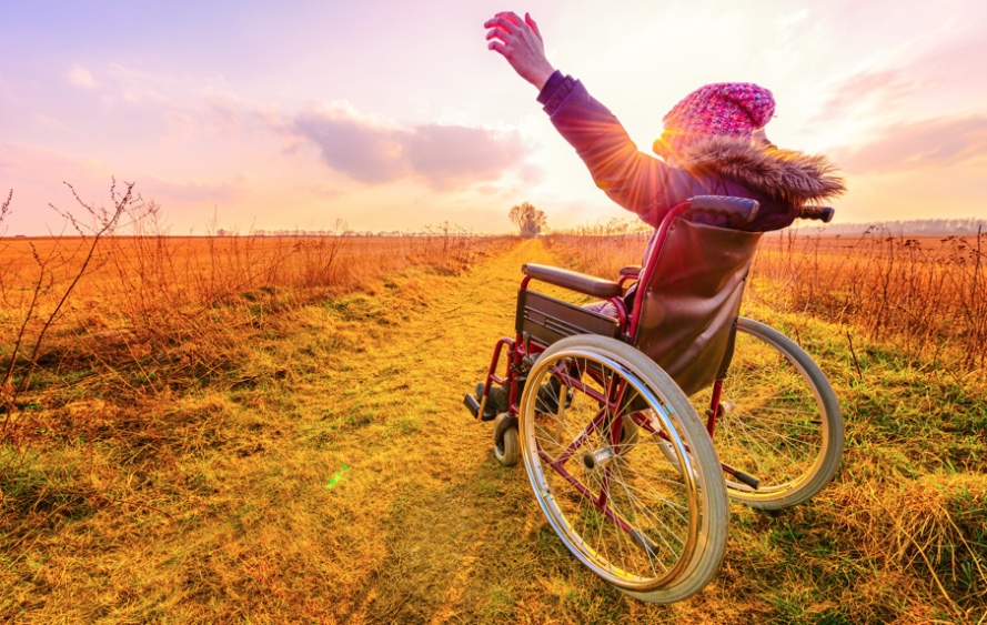 Woman in wheel chair looking at sunset